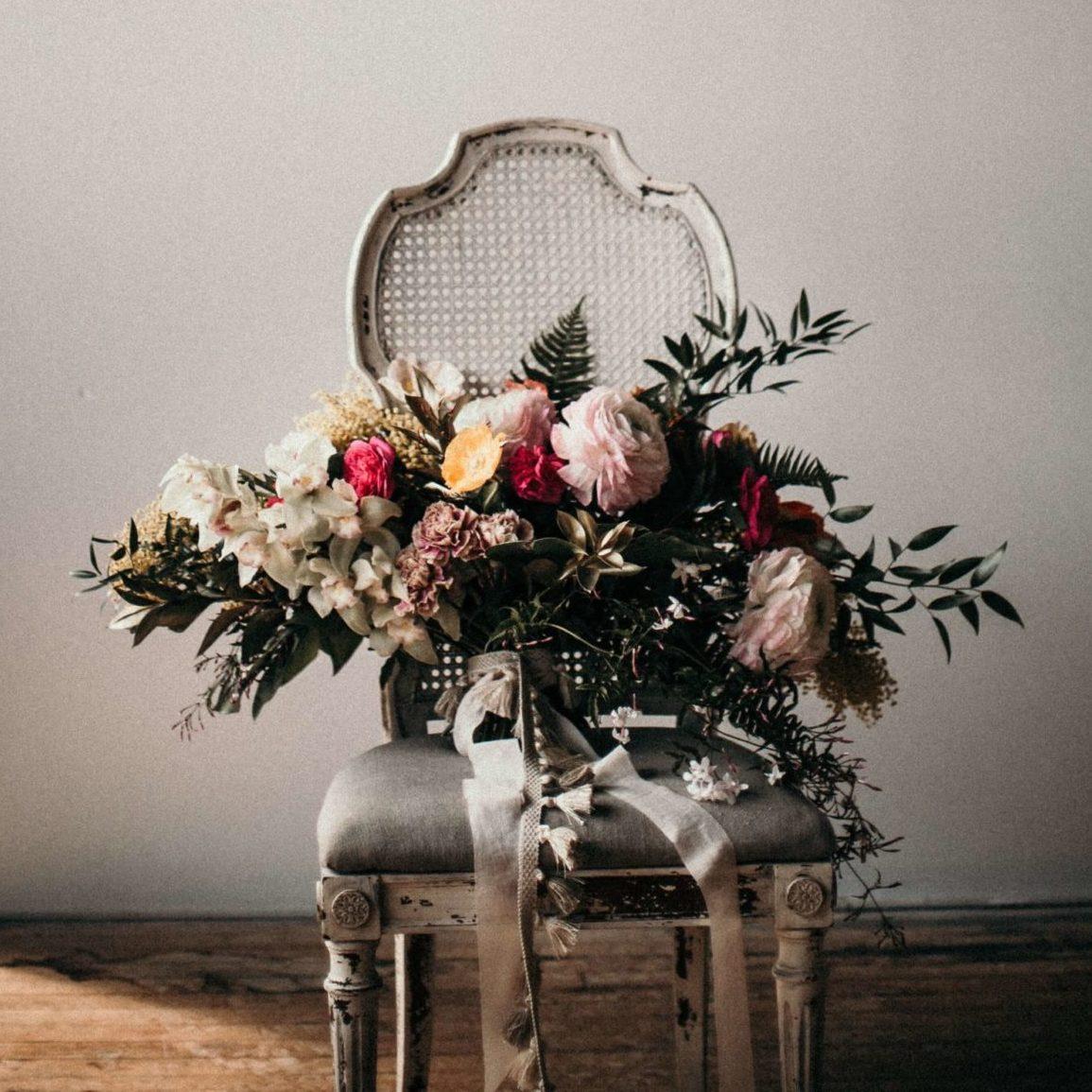Image: Beautiful bridal floral bouquet on antique chair.
