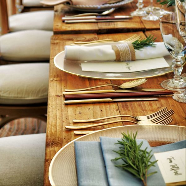 Image: silverware and plates set up for fine dining.